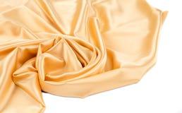 金黄丝绸布料纹理特写镜头  免版税图库摄影