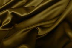 金黄丝绸背景 免版税库存图片