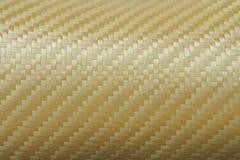 金黄凯夫拉尔纤维纹理  库存图片