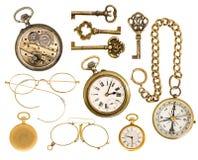 金黄可收回的辅助部件。古色古香的钥匙,时钟,玻璃, co 免版税图库摄影