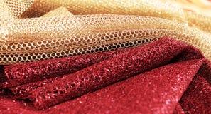 金黄和红色织品 免版税图库摄影