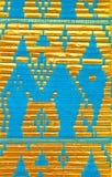金黄和蓝色背景的织品丝绸纹理 免版税库存图片