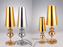 金黄和银色台灯,豪华桌点燃 免版税库存照片