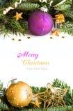 金黄和紫色圣诞节装饰 库存照片