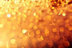 金黄圣诞灯背景 免版税库存照片