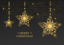 金黄圣诞节担任主角与在黑背景的雪花 免版税库存图片