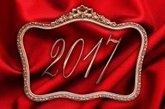 金黄2017年在与红色丝绸的一个古色古香的框架 库存照片
