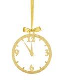 金黄在被隔绝的丝带的圣诞节闪烁装饰时钟  免版税库存照片