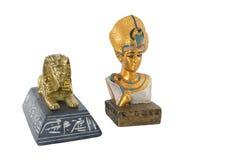金黄埃及法老王和金黄狮身人面象 库存图片