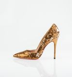 金黄妇女鞋子 库存图片