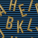 金黄字体绣衣服饰物之小金属片创造印刷品的标签 库存图片