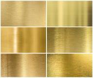 金黄或黄铜金属纹理或背景集合 免版税库存照片