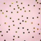 金黄星在桃红色洒 背景欢乐节假日 著名人士 库存图片
