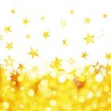 金黄星背景发光的雨  免版税库存图片