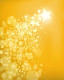 金黄星背景 免版税库存照片