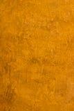 金黄橙色墙壁纹理背景 库存照片