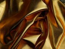 金黄物质缎关闭纹理  免版税库存照片