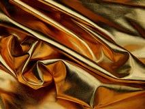 金黄物质缎关闭纹理  免版税图库摄影