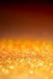 金轻的bokeh纹理或闪烁点燃欢乐金子backgrou 库存图片