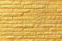 金黄砖墙背景样式纹理 免版税库存照片