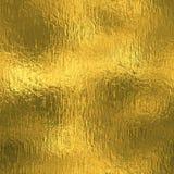 金黄箔无缝和Tileable豪华背景纹理 闪烁的假日起皱纹的金背景 免版税库存照片
