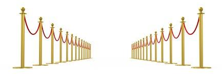 金黄篱芭,有红色障碍绳索的柱子 图库摄影