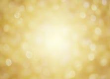 金黄背景的圣诞节 库存照片