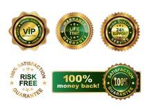 金黄绿色徽章保证 免版税库存图片