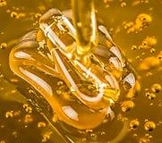 金黄蜂蜜 库存图片