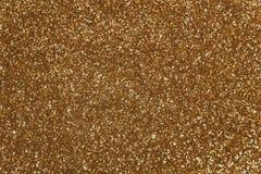 金黄衣服饰物之小金属片-闪耀的闪光金属片的纺织品 库存图片