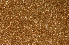 金黄衣服饰物之小金属片-闪耀的闪光金属片的纺织品 免版税库存图片