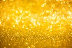 金黄闪烁圣诞节摘要背景 免版税库存图片