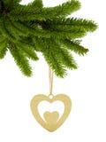 金黄闪烁心脏当在丝带的圣诞节装饰与弓 库存照片