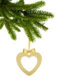金黄闪烁心脏当在丝带的圣诞节装饰与弓 免版税库存图片