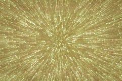 金黄闪烁爆炸点燃抽象背景 库存图片