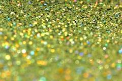 金黄闪烁纹理Colorfull被弄脏的抽象背景 免版税库存照片