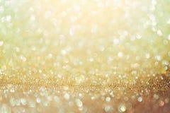 金黄闪烁bokeh背景 发光的背景 库存图片