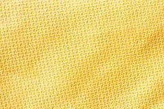 金黄颜色丝绸布料纹理 库存图片