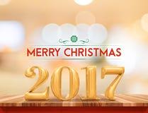 金黄颜色2017圣诞快乐& x28; 3d rendering& x29;在棕色木头t 免版税库存照片