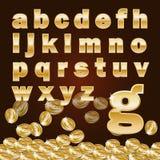金黄alphabet_lowercase和硬币 库存图片