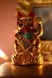 金黄Maneki Neko,幸运的猫 免版税库存照片