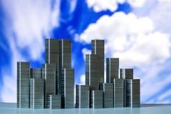 钉书针准备形成在蓝天的城市地平线与白色c 库存图片