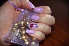 钉牢紫色颜色入设计 库存图片