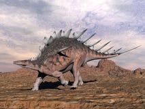 钉状龙恐龙在沙漠- 3D回报 免版税库存图片