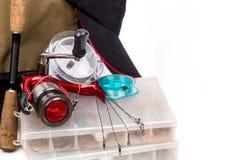 钓具和诱剂在箱子 免版税库存图片