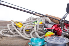 钓具在船上有白色背景 图库摄影