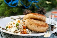 钓鱼与米一道配菜的炸肉排  库存图片