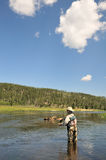 钓鱼中间河 库存图片
