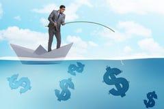 钓鱼从纸小船船的商人美元金钱 免版税图库摄影