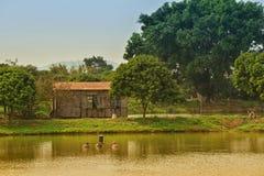 钓鱼和种田村庄 库存照片